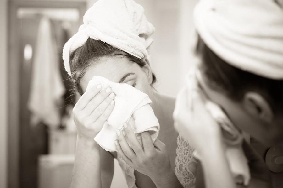 bigstock-Woman-Washing-Face-In-Bathroom-164806238.jpg